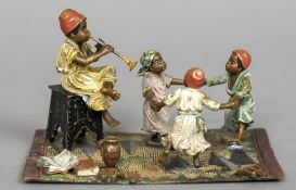 An Austrian cold painted bronze group Worked as children dancing,