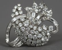 An unmarked platinum and diamond brooch Formed as floral sprays. 4 cm wide.