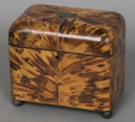 An early 19th century tortoiseshell tea caddy The hinged cover enclosing two lidded compartments,