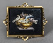 A 19th century yellow metal mounted micro mosaic brooch Worked with the doves of Pliny,