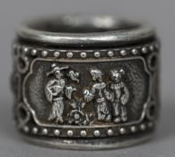 A Chinese white metal archer's ring The rotating band worked with figural vignettes. 3 cm diameter.