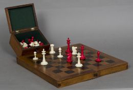 A late 19th century bone and stained bone Staunton pattern chess set Together with a folding