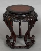 A 19th century Chinese carved hardwood and burrwood inlaid vase stand With pierced and carved apron,