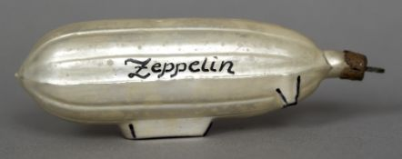 An early 20th century glass Christmas tree bauble Formed as a Zeppelin airship,