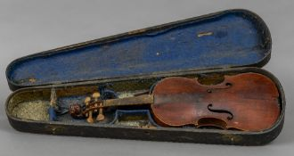 A 19th/20th century violin Of typical form, with lion mask carved scroll, cased. 60 cm long.