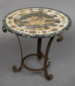 A specimen hardstone topped wrought iron coffee table The circular top centred with Pliny's doves.