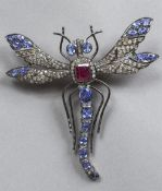 A yellow metal and silver, diamond and gem set brooch Formed as a dragonfly with 925 purity mark.