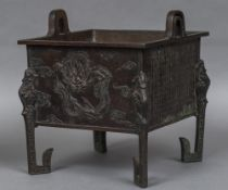 A large Chinese bronze twin handled censor Of square section,