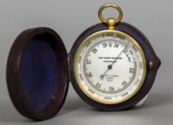A late 19th/early 20th century Negretti & Zambra brass cased pocket barometer Of typical form,