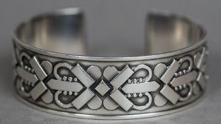 A Danish Sterling silver Georg Jensen bangle Worked with geometric motifs.