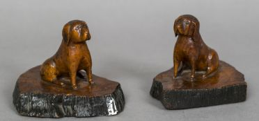 A pair of late 19th/early 20th century models of hounds, possibly Labradors One a dog,