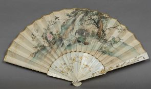A late 19th century shibyama and gilt lacquered ivory guarded fan The main paper body painted to