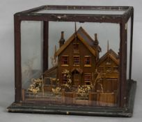 A late 19th/early 20th century country cottage diorama Of typical form, modelled front and back,