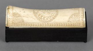 An ebonised rectangular box Mounted with a bone lid carved with a bird. 16 cm long.