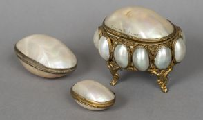 A late 19th century French mother-of-pearl shell mounted casket The hinged lid inscribed Souvenir