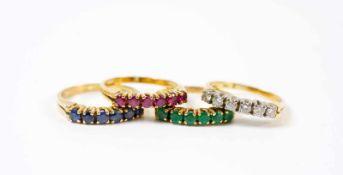 Ringset aus 4 Damenringen 750 Gelb- und Weißgold, Saphir-, Smaragd-, Rubin- und Brillantbesatz,