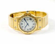 Cartier Damenarmbanduhr, Modell Santos Octagon Date, Automatik, Gehäuse 750 Gelbgold, Durchmesser 28