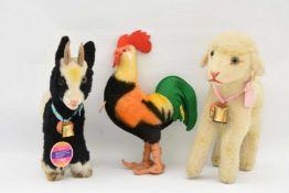 """STEIFF. """"Drei heimische Nutztiere"""", Wolle/Baumwolle/Dralon, Knopffahne und original Steiff-Marke,"""