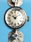 """Damenarmbanduhr, bezeichnet """"Exquisit"""" mit 2 Brillanten, zusammen ca. 0,25 ct, 60- er Jahre 585/-"""