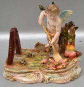Amor mit Schaufel auf Rocaillensockel stehend, beim sammeln der Herzen, leicht best., rest., H 10