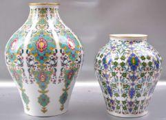 Zwei Vasen rund, leicht gebaucht, mit bunten Ranken und Ornamenten verziert, H 25 cm bzw. H 18 cm,