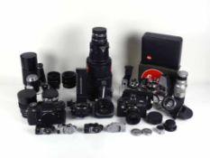 LEICA-Sammlung Teil II 2 Kameras; Leicaflex SL2 und Leica CL; mit div. Objektiven und weiterem