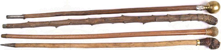 4 GEHSTÖCKE, versch. Holzsorten, L. 88-90 cm, 1 Kugelknauf, Messing, 2 plastisch gearbeitete Knäufe,