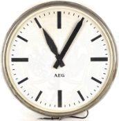 "AEG-WERKSUHR, Typ ""SUEJ"", Gehäuse Eisenblech/vernickelt/verglast, elektr. Betrieb, m. Verkabelung u."