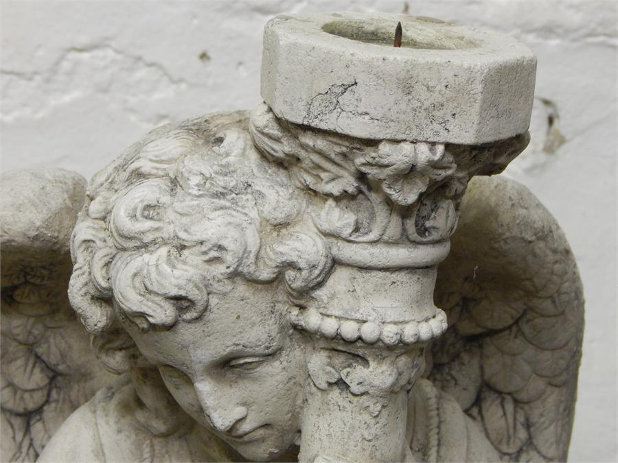 Lot 6 - Two candle pricket stands in the form of winged angels in modern stone-effect resin.