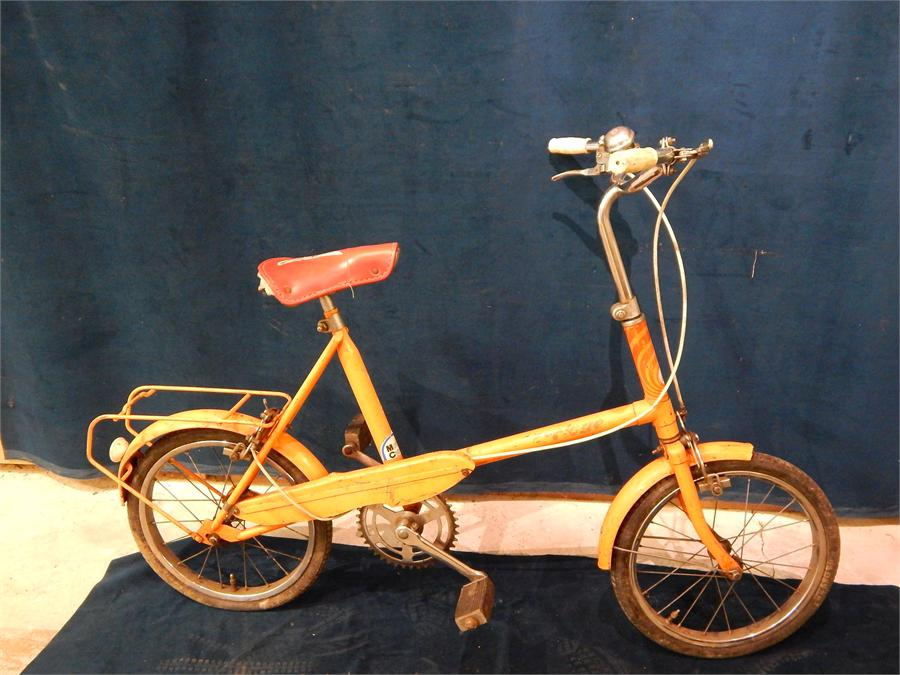 """Lot 46 - Orange Raleigh Cyclone children's bicycle c. 1970`s, red saddle with """" I like it """" emblem."""