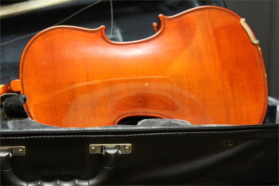 Lot 47 - Quarter Violin in case with bow.