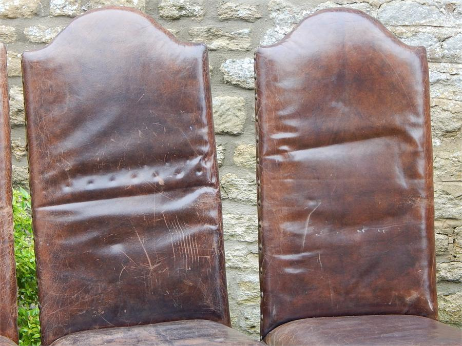 Lot 109 - Six leather studded Cromwellian style dining chairs with six more available off site at hammer price