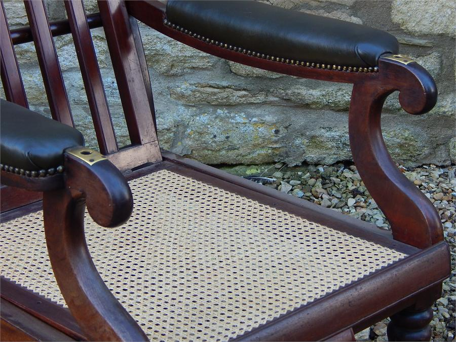 Lot 94 - A William iV Metamorphic Adjustable Reclining Mahogany Bergere Library Armchair, with pull out leg