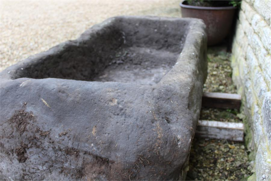 Lot 6 - A Large stone trough garden planter, previously from a farm in Yorkshire, measuring approximately: