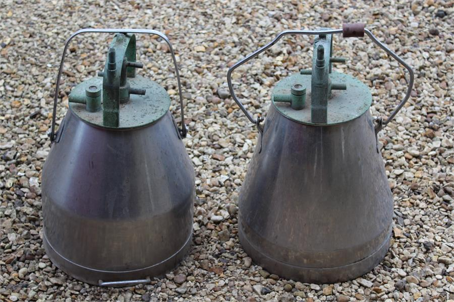 Lot 48 - two milk pasturisers with copper tops.