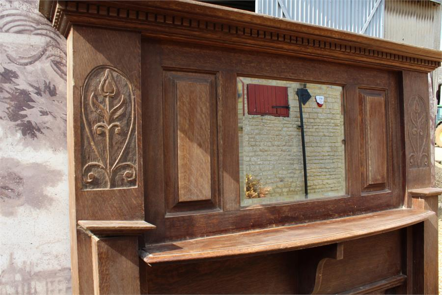 Lot 9 - A large early 20th century oak fire surround chimney piece with carved floral nouveau motif and