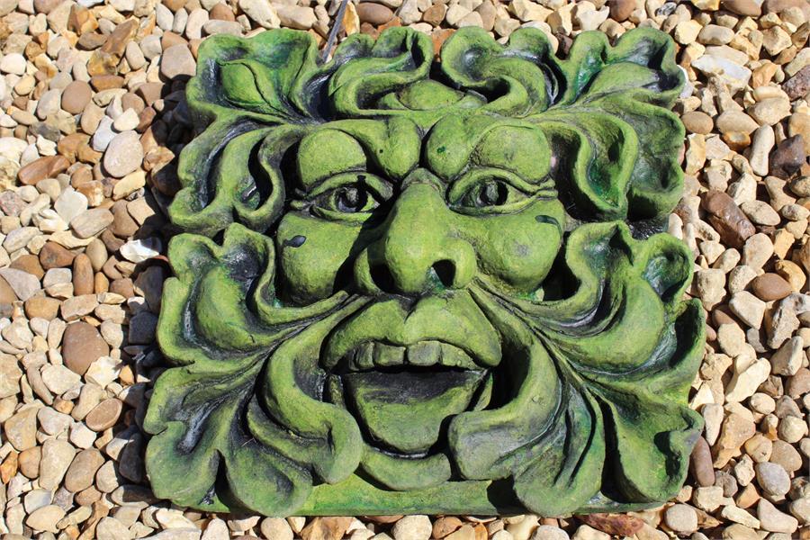 Lot 1 - Weatherproof stone effect green man square in shape.
