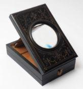 Stereoskop, 19.Jhdt. Graviertes, ebonisiertes Holz. 14x22cm.