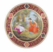 A Vienna polychrome porcelain dish 23,5cm. diam.