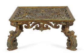 A gilt and lacquered carved coffee table 52x104x104cm.