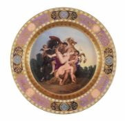 A large Vienna polychrome porcelain plate painted with the scene of the Rape of the daughters of