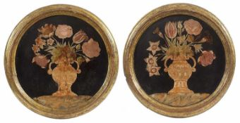 A pair of tuscan scagliola circular medallions each representing a flower vase, 18th century,