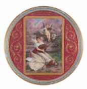 A large Vienna polychrome polcelain plate painted with a musical allegory, late 19th century,