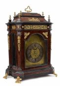 A large bois de violette and ormolu Louis XV mantel clock signed recto/verso Johann Georg Rieff in
