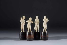 Four Dutch ivory sculptures of a musician standing on a barrel 19th century, total height 15cm.