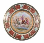 A Vienna polychrome porcelain plate painted with Apollo's wagon, early 20th century, 32cm. diam.
