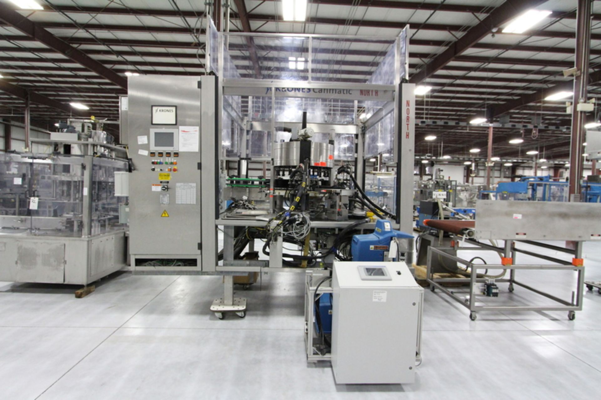 2003 Krones 18-Head Canmatic Wrap Around Rotary Labeler