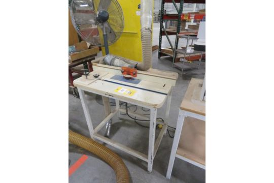 Dewalt router model dw618 mounted on 24 in x 32 in table greentooth Choice Image