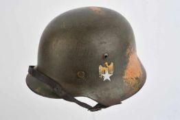 Casque double insignes de la Heer. Coque de casque modèle 35 de fabrication NS. Peinture vert
