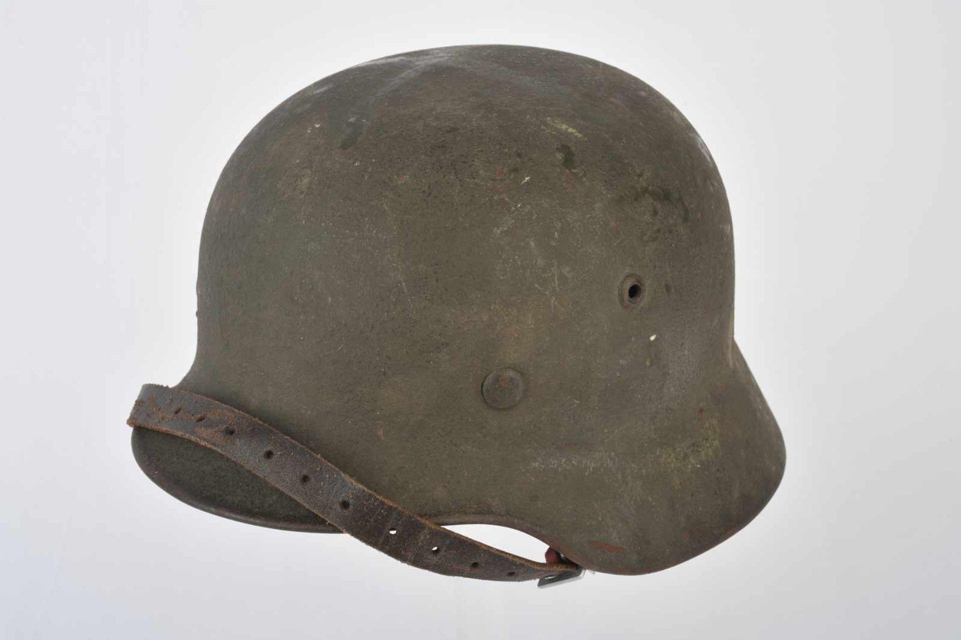 Casque nominatif de la Heer. Coque de casque 40, fabrication «Q62», numéro de lot illisible.